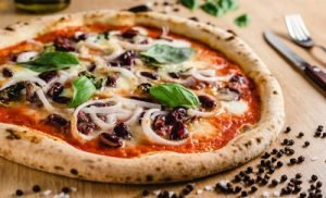 Chilocalorie Pizza: Lievitano con Condimenti e Ingredienti